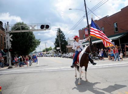 Guyula Johnson leads the Rolling Fork Iron Horse Parade on Main Street in New Haven Saturday.