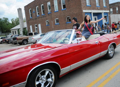 Sydney Varney, New Haven, throws candy to bystanders at the Rolling Fork Iron Horse Festival Parade Saturday. Varney was crowned 2011 Iron Horse Queen.