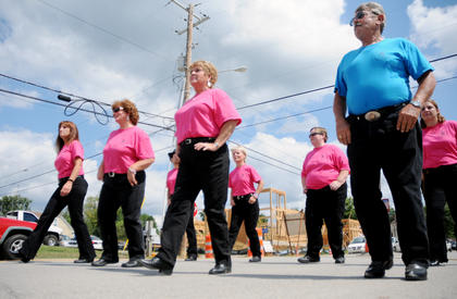 The Highway 210 Hillbillie Stompers line dance at the Rolling Fork Iron Horse Festival in New Haven Saturday.