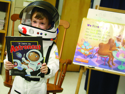 "Dressed as an astronaut, Jack Cecil, a kindergartner at Cox's Creek Elementary, discusses what he learned after reading ""If I Were An Astronaut"" to his classmates during Character Day Thursday at Cox's Creek Elementary. The annual event is part of the school's Reading is Fundamental Grant, in which the school works to connect reading standards and literature. Each student is asked to read a book and be prepared to discuss a character from their reading."