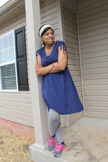 Kimberly Phillips gets a view of her neighborhood from the front porch of her new Habitat home.
