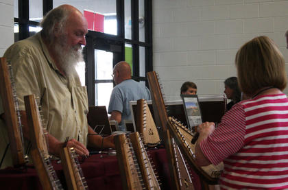 Greg Westman shows participants a variety of bowed psalteries and other folk instruments.