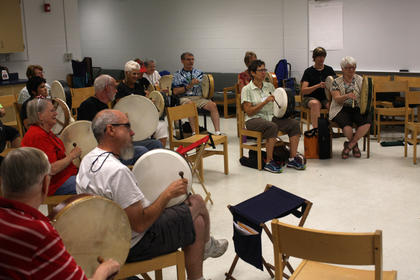 KMW participants take a percussion class.