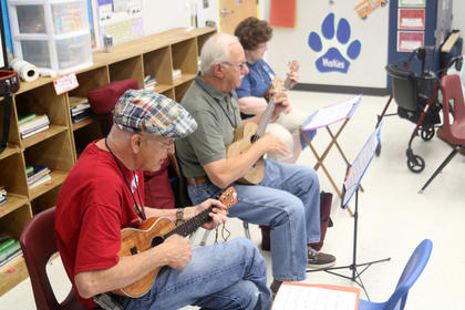 Participants practice songs for a lesson during Kentucky Music Week.
