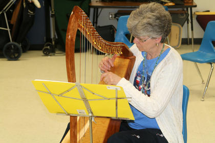Phyllis Howard plays along during a lesson by DeeDee Tibbits at Kentucky Music Week.