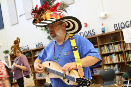 On Friday, instructors gathered in the library for a mardi gras parade during Kentucky Music Week.