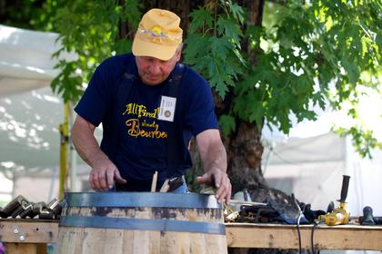 Donnie Votaw with Kentucky Cooperage demonstrates the art of barrel making on the lawn of Spalding Hall Saturday.