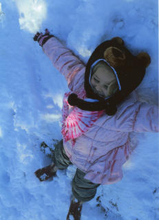 Kate Long enjoys making snow angels.