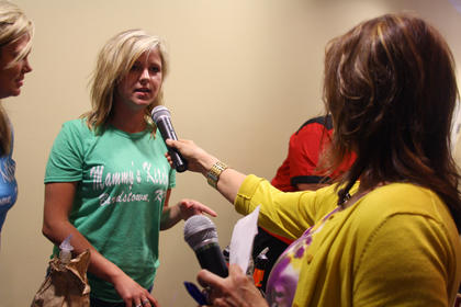 """Robyn Thomas, manager of Mammy's Kitchen, fields a question about her mixed drink, """"Downtown Basil Brown,"""" from Kim Huston, president of the Nelson County Economic Development Agency, at Wednesday's Mixed Drink Challenge."""