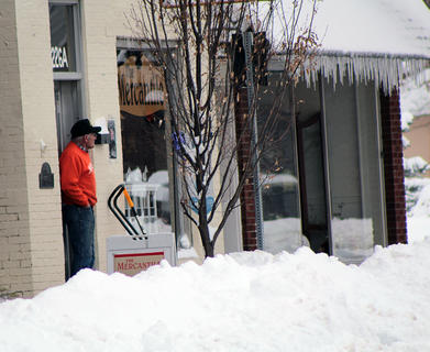 Buddy Gulden, owner of The Mercantile, stays open during Thursday's snow event.
