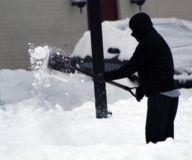 An individual works to clear a path following nearly two feet of snowfall in Nelson County.