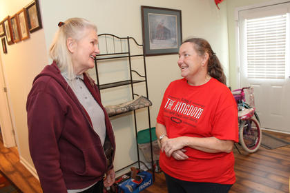 Habitat board member Mary Vanderveer, left, talks with new homeowner Sharon Bolin inside her house Sunday afternoon.