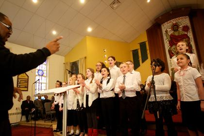 The Bardstown Elementary Chorus, under the direction of Lederrick Wesley, performs Monday at the Martin Luther King Jr. Celebration at St. Monica Church.