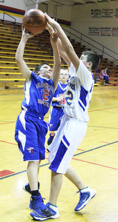 Alex Vittitow (right) of New Haven challenges a shot by Bloomfield's Jacob Beam.