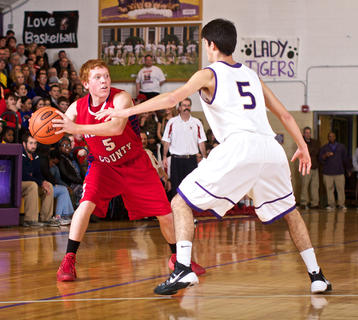Nelson County's Austin Ellis looks for a teammate to pass to against Bardstown's Nicolas DeVillalobos during the Tigers' 68-42 win Jan. 10.