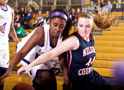 Bardstown's ShaTonda Calbert, left, and Nelson County's Kaylee Hall chase down a loose ball under the basket during the Cardinals' 70-50 win Jan. 10.