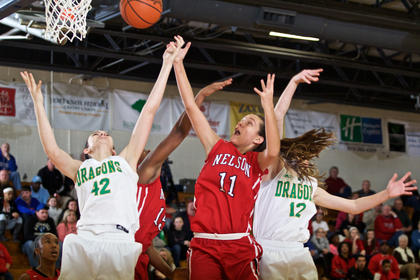 Nelson County's Brooklyn Greer (11) and LeLe Linton (rear) battle with Green County's Whitney Perrian, left, for a rebound in the Cardinals' 57-51 region semifinal win Friday at North Hardin. Nelson County's win put them in the 5th Region title game for the first time since 2005.