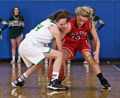 Nelson County's Kira Harman, right, battles for a loose ball with a Green County player.