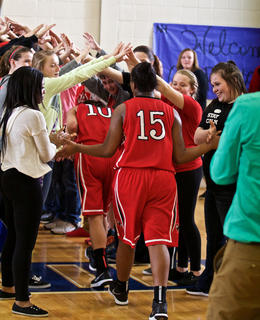 Nelson County fans make a tunnel for the Cardinals players into the locker room after a 62-43 win over North Hardin Tuesday.