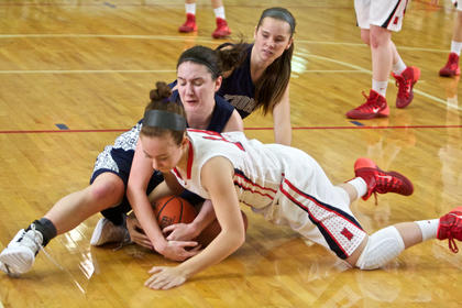 Nelson County's Taylor Young and Thomas Nelson's Kaylee Dickson scramble for a loose ball during the Cardinals' 58-17 win Jan. 23.