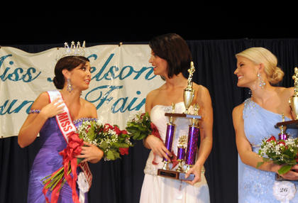 Alex Jordan Perkins, 21, Hardin County, is crowned Miss Nelson County Fair 2011. First runner-up Ashley Renee Young, 21, Morganfield and Allie Shae Hash, 20, Campbellsville, look on.