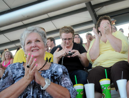 Laura Welker (L) applauds with other audience members during the Miss Nelson County Fair Pageant.