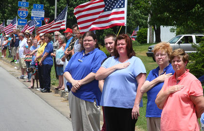 Thousands of people gathered along the funeral procession route to honor slain Bardstown Police Officer Jason Ellis, including these folks on North Third Street near where the procession turned onto John Rowan Boulevard.