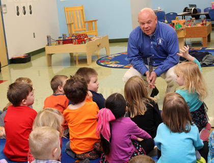 Mayor John Royalty talks with kids at the Nelson County Early Learning Center after reading to them as part of the district's Dr. Seuss month.