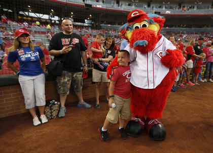 Parker Ellis, 6 son of slain Bardstown police officer Jason Ellis was all smiles as he got a hug from the Cincinnati Reds mascot Gapper prior to their game against the Pittsburgh Pirates at Great American Ball Park. The Enquirer/Jeff Swinger