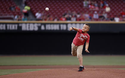 Parker Ellis, 6 son of slain Bardstown police officer Jason Ellis throws out the ceremonial first pitch before the Cincinnati Reds game against the Pittsburgh Pirates at Great American Ball Park. The Enquirer/Jeff Swinger