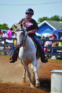 The Red Neck Rodeo was held at the Nelson County Fairgrounds Saturday to benefit the Kentucky Home Chapter of Hearing Loss Association of America. The rider above participates in a catalog race.