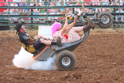 """Rodeo clown Brandon Downs, left, and his """"wife Darlene"""" entertain the crowd Wednesday at the Nelson County Fair."""