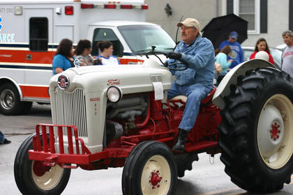 Ron Greenwell drives a tractor in the parade.