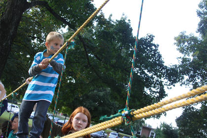 Charlie Miller, 6, of Bardstown, looks ahead while completing a ropes course during the annual Rotary Club Kids Day.