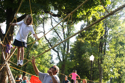 Avery Settles, 7, of Bardstown, focuses as she climbs a ropes course in front of Bardstown City Hall for the annual Rotary Club Kids Day.