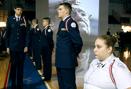 Nelson County High School Air Force Junior ROTC members Cadet Sarah Sztanya, sophomore, right, and Dep. Devin Brown, junior, second to right, line up at attention in during the school's Veterans Day ceremony.
