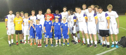 Members of the Nelson County U10 Blue Elite Soccer Team served as ballboys for Saint Catherine College's first men's soccer home game against Oakland, Ind. Ballboys included (front, in blue) Braxton Hite, Alex Dadison, Owen Higdon, Donvovan Willis and Connor Fulkerson.