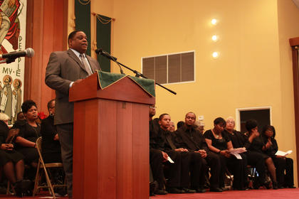 Bill Sheckles introduced the dignitaries from Nelson County school systems and from the county and city governments present at the celebration of Martin Luther King Day at St. Monica Catholic Church Monday. Sheckles was master of ceremonies for the previous 10 years.