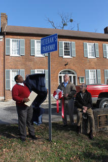 Bardstown Mayor Bill Sheckles unveils the new sign for Veterans Parkway, the section of Second Street down to Old Bloomfield Pike. To his right are Councilman Bobby Simpson and former Mayor Chuck Brauch.