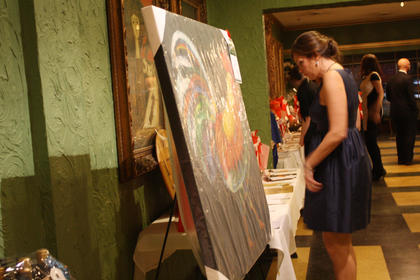 A woman browses various items featured in the silent auction at the Beautiful Dreamer Ball Saturday night at Kreso's.