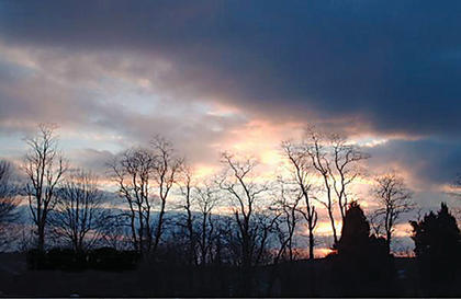 """Stump took this picture  in 2007 from the back porch of her house in Cox's Creek. """"Kentucky has some of the most beautiful sunsets, and we had the best backdrop for them from our back porch,"""" she said."""