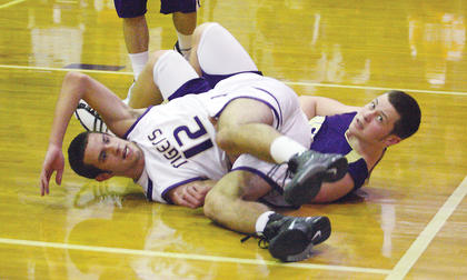 Nathan Hall looks for an official's call after colliding with a Campbellsville player Saturday.