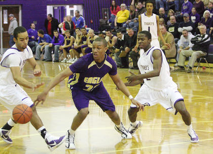 Bardstown's Jordan Brewer slips in behind Campbellsville's Jordan Percell for a key steal in the fourth quarter.