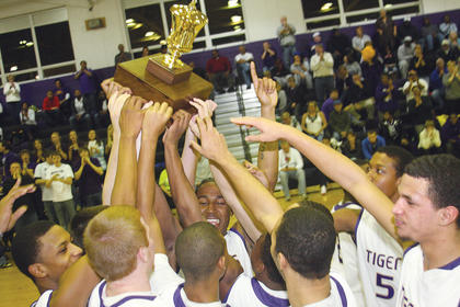 Tiger players hoist the trophy after winning the All A Classic 5th Region title Saturday.