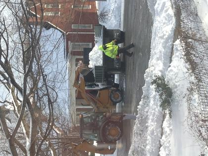 A city crew clears snow on East Broadway in Bardstown.