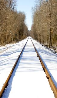 By Monday afternoon the sun had melted much of the snow that fell in the early morning hours, exposing the tracks along the railroad through the Nelsonville area.