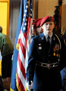 Members of the Nelson County High School ROTC stand at attention moments before a ceremony to unveil the Christmas stamp for 2011 at Nazareth Friday.