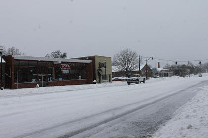 Conditions on even the main roads, such as Stephen Foster Avenue in Bardstown, were hazardous Thursday after a snowstorm dumped more than a foot of heavy, wet snow on Nelson County.