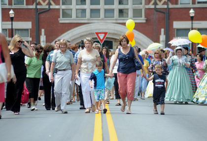 JUNE 3, 2011: Bardstown residents walk along Third Street during the completion ceremony Friday.