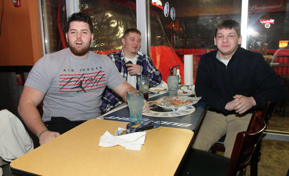 Trey Franklin of Bardstown, left, was rooting for the Patriots during the Super Bowl Sunday at Buffalo Wings and Rings while his companions, Roger Collins, center, and Jacob Stafford were Seahawks fans.